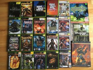 Large Lot 20 Xbox games and 3 Strategy Guides for Sale in Steilacoom, WA