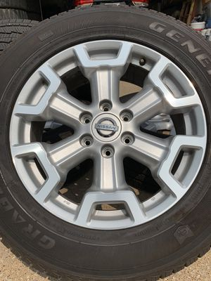20 INCH OEM NISSAN TITAN AND ARMADA RIMS WITH GOOD TIRES AND LUG NUTS for Sale in Grand Prairie, TX