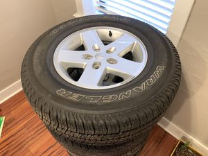 """Jeep Wrangler 17"""" Factory OEM Wheels Tires Goodyear P255/75R17 for Sale in St. Louis, MO"""