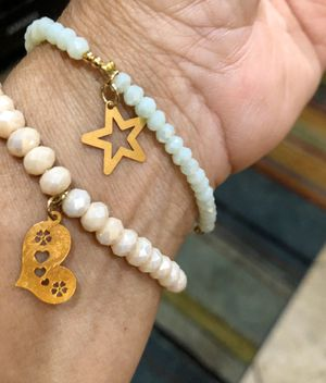 Two pretty bracelets with natural frosty stone beads and gold charms. Both for $5. for Sale in Tolleson, AZ