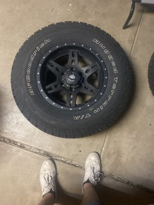 4 BFGoodrich 4x4 tires (P265/70R16) with black rim for Sale in Denver, CO