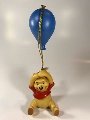 Walt Disney Classics Collection Pooh flying with a balloon ornament. Along with commemorative pin and Certificate of Authenticity. Have many more fig for Sale in Attleboro, MA