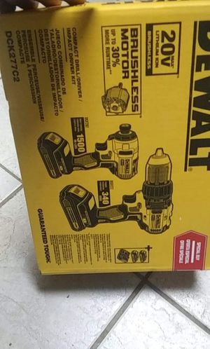 De walt drill and impact 20 volt brushless motors 2 batteries and charger brand new 100 piece bit set also for Sale in Bakersfield, CA