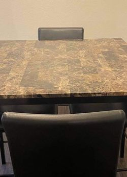 Nice hightop dining table with four lather chairs for Sale in Phoenix,  AZ