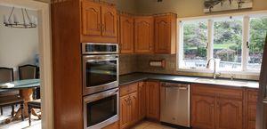 Used solid oak kitchen cabinets for Sale in Warren, NJ