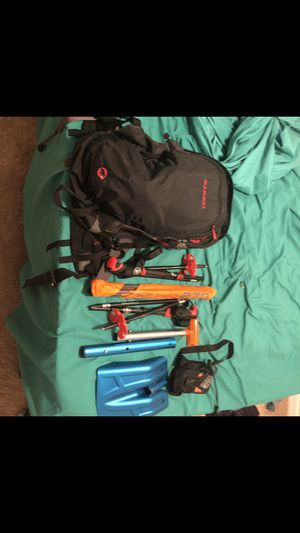 Mammut avalanche backpack, beacon, probe, shovel, and black diamond poles. for Sale in St. Petersburg, FL