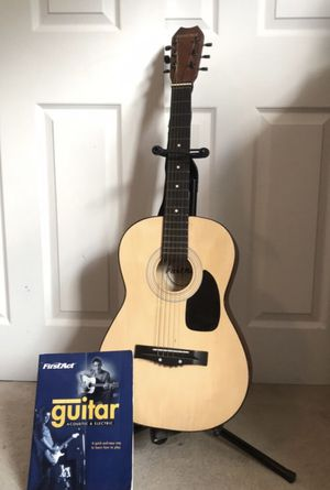 First Act Guitar with Stand and Book for Sale in Staten Island, NY