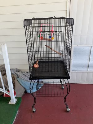 Nice big cage on its own stand with wheels for Sale in Palm Bay, FL