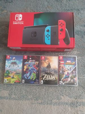 Nintendo switch with 4 games for Sale in East Wenatchee, WA