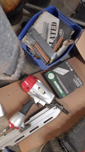 Air mail gun and 2 boxes nails for Sale in Victorville, CA