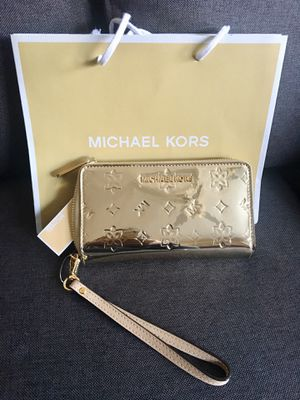 Michael Kors Wristlet Wallet Gold for Sale in Coppell, TX