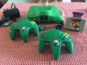 Green clear Nintendo 64 w Mario Party game 2 green original Controllers and cables for Sale in National City, CA