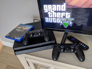 PS4 slim with 2 controllers and 2 games for Sale in Beachwood, OH