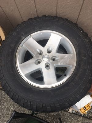 Jeep 5 aluminum wheels and tires for Sale in Buckley, WA
