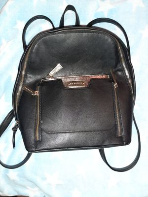 Big Buddha black faux leather mid size backpack. Removable metallic accessories bag. Great condition. for Sale in Murray, UT
