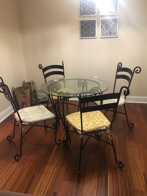 Glass top table with metal legs and 4 chairs for Sale in Philadelphia, PA