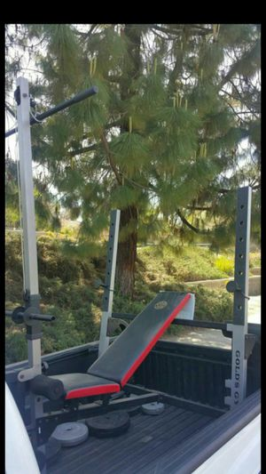 Gold's Gim exersise machine station olimpic works out all your body bench, stand for weight, has a pull bar, and legs work out, and table for arms for Sale in Moreno Valley, CA