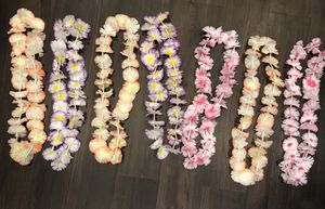 Hawaiian themed party decorations - plastic flower garlands and luau table skirt for Sale in Fremont, CA