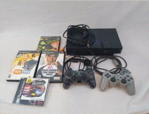 Sony Playstation 2 (PS2) Bundle 4 Games 8MB Memory Card Joysticks Controllers for Sale in Cleveland, OH