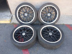 set of 5 lug multipattern 18 inch black and chrome rims with tires for Sale in Montebello, CA