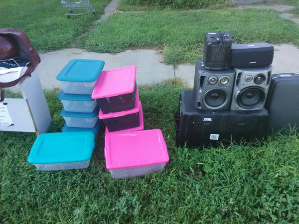 Speakers plastic tubs few clothes bowling ball with shoes ball and bag suitcase with $20 all speakers 80 and 100 watts.