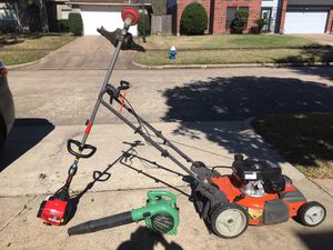 Gardening equipment including weed whacker, leaf blower, and lawnmower for Sale in Houston, TX