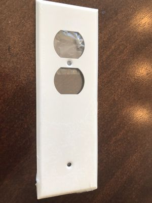 Electric wall plate receptacle cover tandem for Sale in Chicago, IL