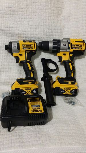 ( PRICE IS FIRM ) DEWALT BRUSHLESS XR HAMMERDRILL DCD996 HIGHT TORKE 3 SPEED IMPACT DRILL 2-4AH XR BATTERIES AND 12 - 20V CHARGER WITH CARRING BAG for Sale in Salisbury, NC