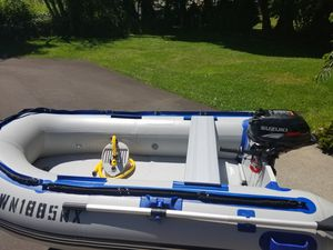 Sea Eagle 8.10T Inflatable Boat and Suzuki 2.5 Outboard Motor for Sale in Portland, OR