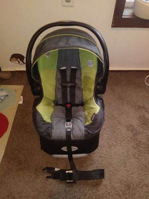 Green and blackEvenflo car seat and base like new with cozy cover for Sale in Columbus, OH