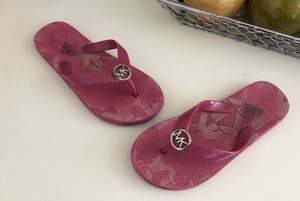 Authentic Michael Kors girls flip-flops sandals with silver metal logo size 2/3 use with lots of life for Sale in Fremont, CA