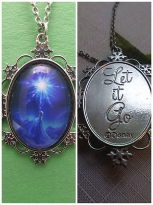"Frozen 2 Sided ""Let it Go"" Necklace for Sale in Grove City, OH"
