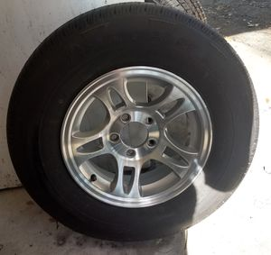 Brand new Rainier 215/75/14C trailer tires with rim for Sale in Brooksville, FL