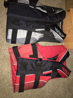 Fly racing life jackets. Red size s/m black size xs for Sale in Lakeland, FL