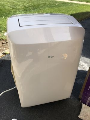 LG Electronics 8,000 BTU (5,500 BTU,DOE) Portable Air Conditioner, 115-Volt w/ Dehumidifier Function and LCD Remote in White for Sale in Naperville, IL