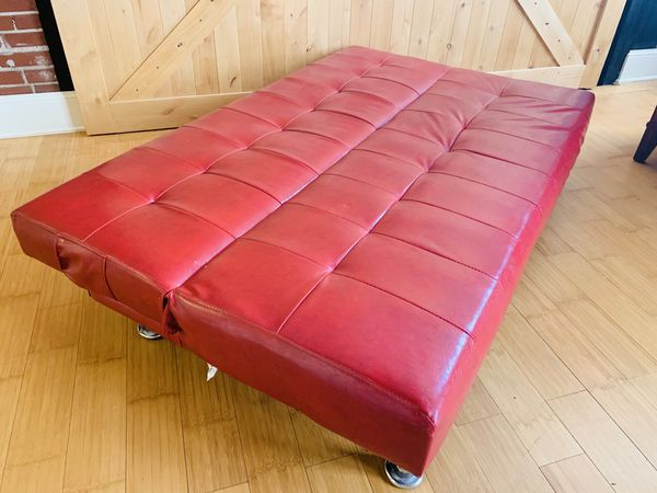 Perfect condition red leather couch/fold out futon.
