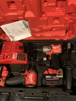 Milwaukee M18 Fuel Drill Set With Two Batteries Charger for Sale in West Valley City,  UT