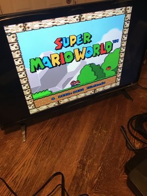 Super Nintendo with 2 controllers and cables and 4 games for Sale in Chicago, IL