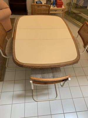 Table Formica insert with wood finish with leaf and 4 chairs for Sale in Phoenix, AZ