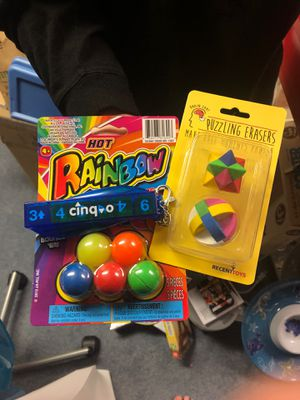 Bouncy balls, puzzle erasers, and cinq-o game for Sale in Dublin, OH