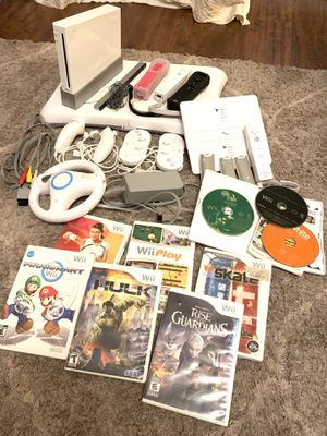 Nintendo Wii Console Bundle- Balance Board Controllers Charge Station Nunchucks for Sale in Antelope, CA