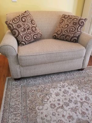 Tan sleeper sofa love seat with decorative pillows for Sale in Browns Summit, NC