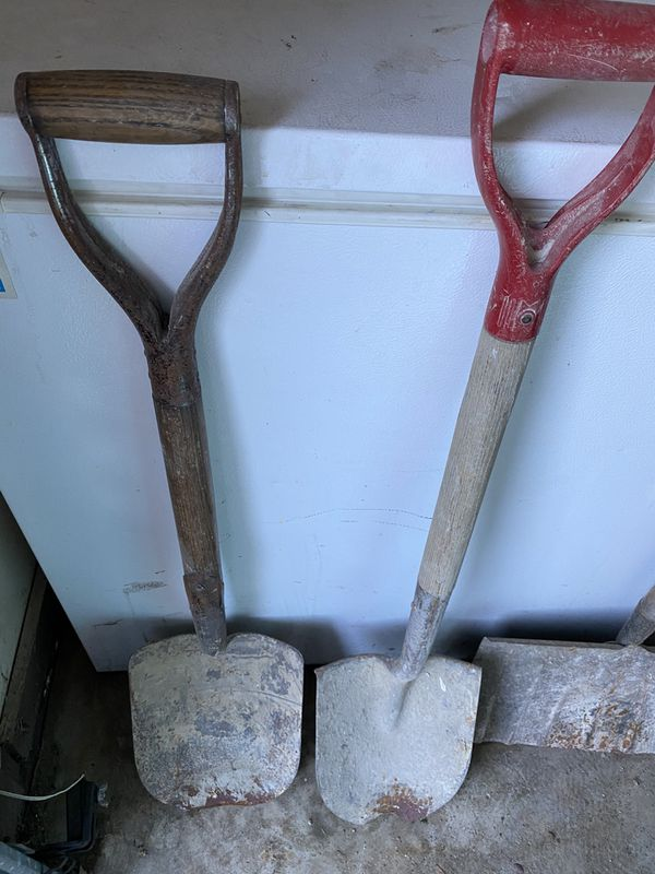 Antique Shovels and rake with wooden handles