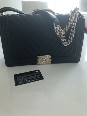 Chanel chevron + dust bag and authenticity card for Sale in Tampa, FL