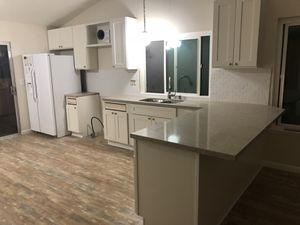 Kitchen cabinets and laminate flooring for Sale in Moreno Valley, CA