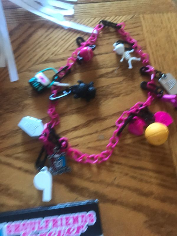 Monster high books, DVD movies, stuff animals, watch, and necklace all together there are 10. DVD & 6. Books 3 Stuff animals 1. necklace 1. watch