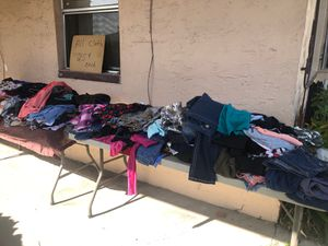 Clothes $1 fill a bag 169 palm dr w.h sept21 for Sale in Winter Haven, FL