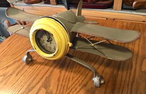 Antique Clock-Faced Metal Airplane w/ internal hidden storage area behind the clock for Sale in Portland, OR