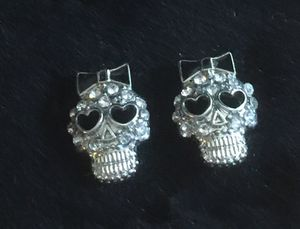 1/2 inch silver tone skull pierced earrings - silver tone clear stones for Sale in Bothell, WA