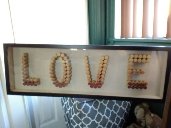 Love wall decoration made of wine tops